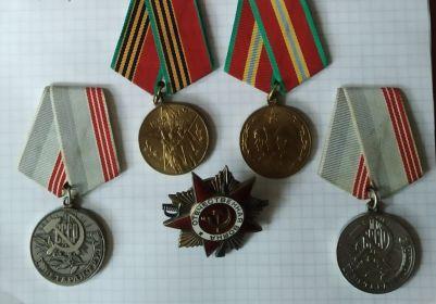 Орден отечественной войны, 70 лет вооружённых сил СССР, 40 лет победы в великой отечественной войне 1941-1945г., за долголетний добросовестный труд.