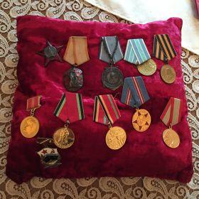 Награды боевые ,в том числе медаль Ушакова